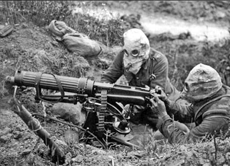 Machine gun crew with gas masks